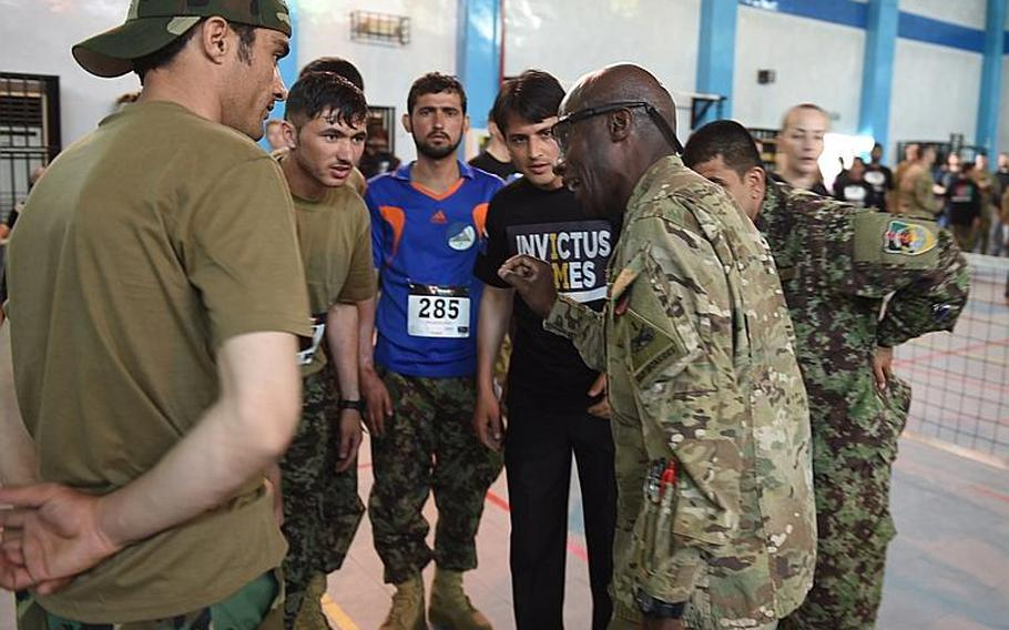 Sgt. Maj. Eugene Russell coaches a group of wounded Afghan soldiers at trials for the Afghan team to the 2017 Invictus Games, at Resolute Support headquarters in Kabul, Afghanistan, Saturday, May 13, 2017.