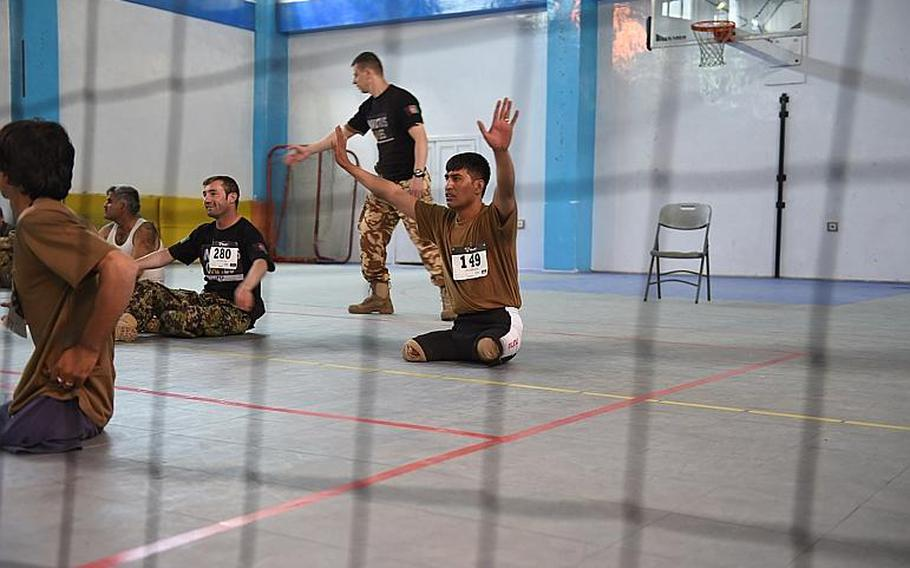 Nasir Ahmad, 27, who lost his legs after stepping on an IED in Helmand in 2015, competes for a slot on Afghanistan?s team for the 2017 Invictus Games,at Resolute Support headquarters in Kabul, Afghanistan, Saturday, May 13, 2017. Later that afternoon, he found out would be headed to the games in Toronto this fall.