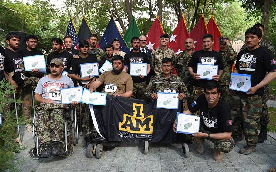 The team of wounded Afghan soldiers selected to represent their country in the 2017 Invictus Games, shows off certificates at the team trials closing ceremony at Resolute Support headquarters, Kabul, Afghanistan, Saturday, May 13, 2017.