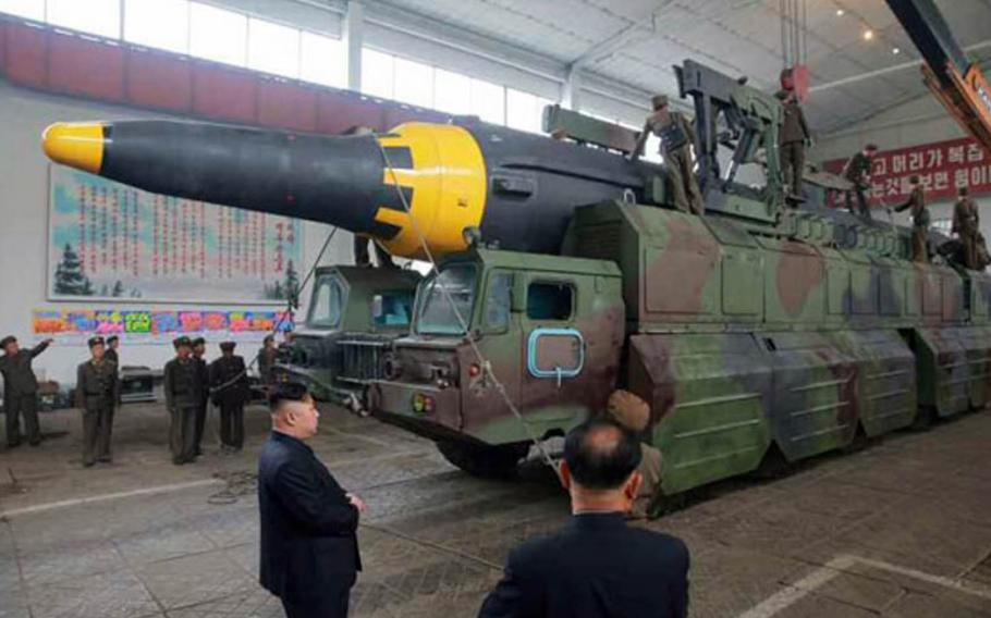 North Korean leader Kim Jong Un is shown watching a missile being loaded onto a launcher in this undated photo published Monday, May 15, 2017, in the official Rodong Sinmun newspaper.