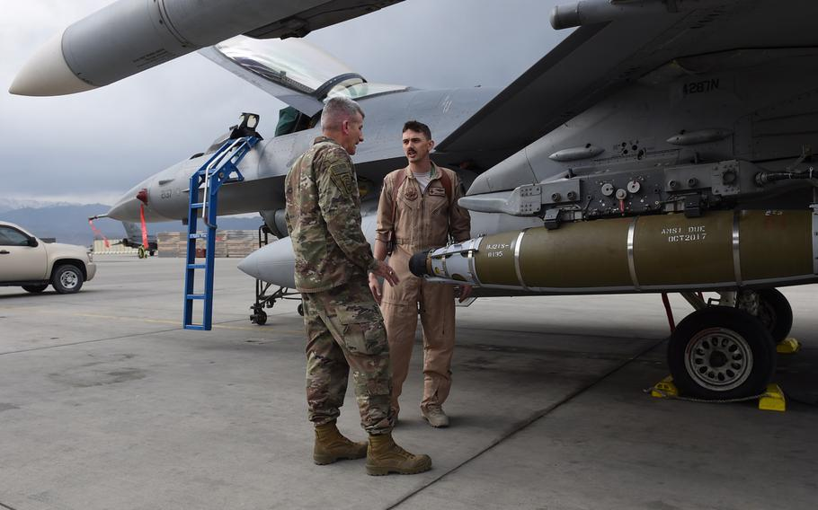 An F-16 pilot from the 555th Fighter Squadron, from Aviano Air Base, Italy, explains to Gen. John Nicholson, the top commander of U.S. forces in Afghanistan, the various ordnance used against terrorist organizations in the country. Nicholson visited pilots and airmen form the 555th at Bagram Air Field, on Saturday, May 13, 2017.