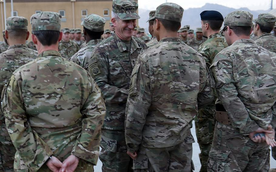 Gen. John Nicholson visited troops serving with NATO Special Operations Component Command-Afghanistan, and gave coins to 18 of them in recognition of their specific contributions to the counter-terrorism fight, on Saturday, May 13, 2017, at Bagram Air Field. Name-tapes have been blurred to protect troops' identities.