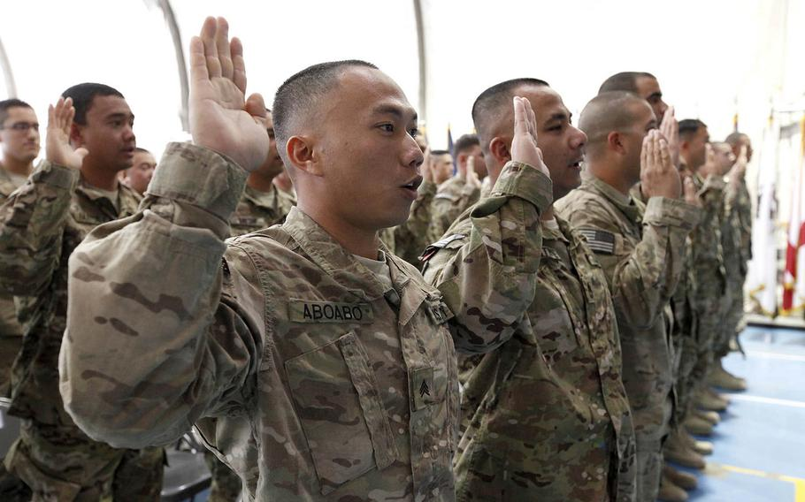 U.S. troops recite their oath of allegiance as they are sworn in as naturalized citizens on Nov. 2, 2012, at Bagram Airfield in Afghanistan.