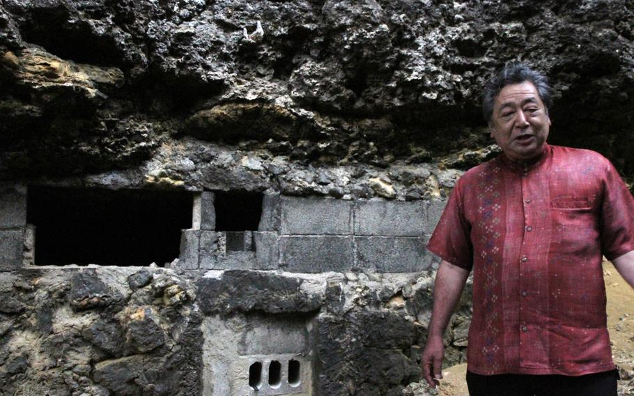 It was a steep climb for Mitsuo Nishishinya, Heshikiya's district mayor, to get to ancestral tombs atop a steep jungle hill at White Beach Naval Facility, Okinawa. However, thanks to servicemembers stationed on Okinawa's only joint U.S.-Japanese base and their families, not only have the tombs been spared from development, but the jungle has also been cleared and steps built, making visiting the tombs of his forefathers easier and more accessible.