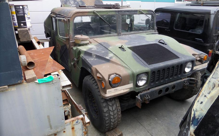An American soldier and six South Korean civilians have been accused of stealing three Humvees from an unnamed U.S. base in South Korea and trying to sell them.