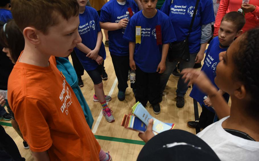 Athletes wait to receive a ribbon for participating in game of volleyball on Friday, May 19, 2017, during the KMC Rheinland-Pfalz Special Olympics. The second annual spring games at Ramstein Air Base, Germany, were held at the Southside Fitness Center. The rain forced most activities indoors.