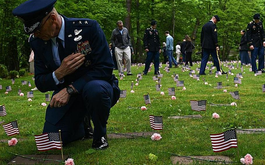 Maj. Gen. Timothy M. Zadalis, U.S. Air Forces in Europe and Air Forces Africa vice commander, pays his respects at the gravestone for Gary Currie, an infant who died in 1952, during the Ramstein Area Chief's Group and German-American and International Women's Club's Kindergraves Memorial Service in Kaiserslautern, Germany, May 20, 2017.