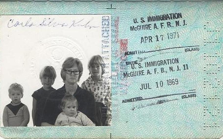 Elizabeth Kuhn is pictured, from left to right, with her brother, Billy, and sisters Mary and Katrina, and held by her mother, Carla Syliva Kuhn, in the family's passport photo. Elizabeth died at 20 months of age in 1968. She is buried in the Kindergraves in the Kaiserslautern city cemetery in Germany.