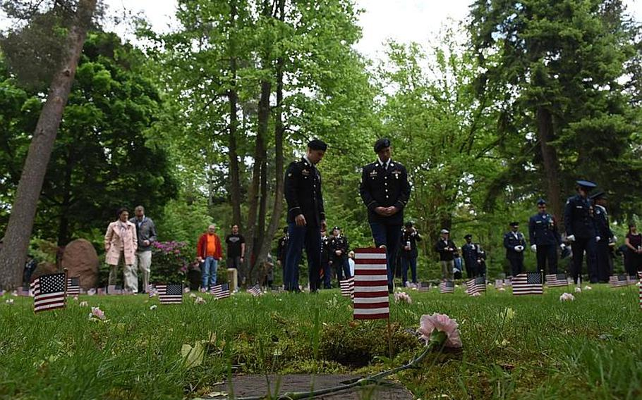 Military personnel and local community members walk among the Kindergraves on Saturday, May 20, 2017, in Kaiserslautern, Germany. Germans and Americans remembered the 452 American children buried in the Kindergraves during an annual memorial ceremony.