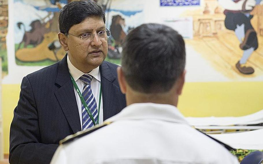 American Mission Hospital chief medical officer George Cheriyan shows Vice Adm. Kevin M. Donegan, U.S. Naval Forces Central Command commander, the children's ward of the hospital on Sunday, May 21, 2017, where the walls are covered in Disney artwork painted by U.S. Navy sailors years ago.