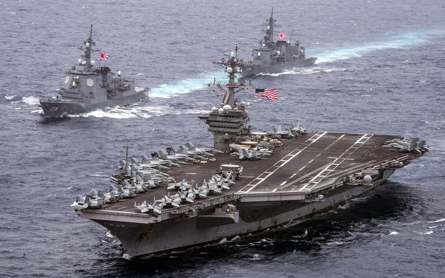 The aircraft carrier USS Carl Vinson, foreground, the Japan Maritime Self-Defense Force destroyers JS Ashigara, left, and the JS Samidare transit the Philippine Sea in April.