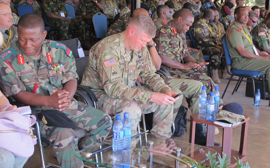 Maj. Gen. Joseph Harrington, commander of U.S. Army Africa, sits to the right of Malawi's defense forces chief Gen. Griffin Spoon Phiri at a peacekeeping demonstration in the Malawian capital during the African Land Forces summit on May 9, 2017. Next year's summit will be in Nigeria.