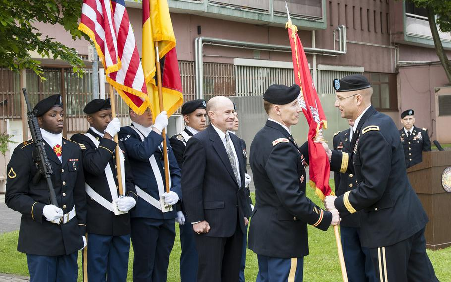 Col. John K. Baker, incoming commander of U.S. Army Corps of Engineers Europe District, accepts the colors from Brig. Gen. William H. Graham, USACE North Atlantic Division commander, during a change-of-command ceremony May 24, 2017, at the Amelia Earhart Center in Wiesbaden, Germany.