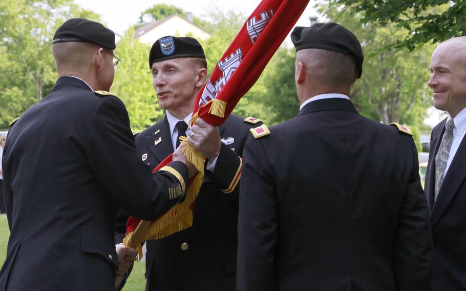 Col. John Baker, commander of Europe District, U.S. Army Corps of Engineers, accepts the colors from Brig. Gen. William Graham, commander of the North Atlantic Division, U.S. Army Corps of Engineers, during a change-of-command ceremony May 24 at the Amelia Earhart Center in Wiesbaden, Germany.