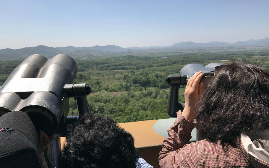Tourists look at North Korea from a viewing platform in South Korea near the Demilitarized Zone, Wednesday, May 24, 2017.