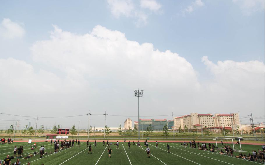 Soldiers play football during the 1st Armored Brigade Combat Team, 1st Infantry Division's centennial celebration at Camp Humphreys, South Korea, Wednesday, May 24, 2017.