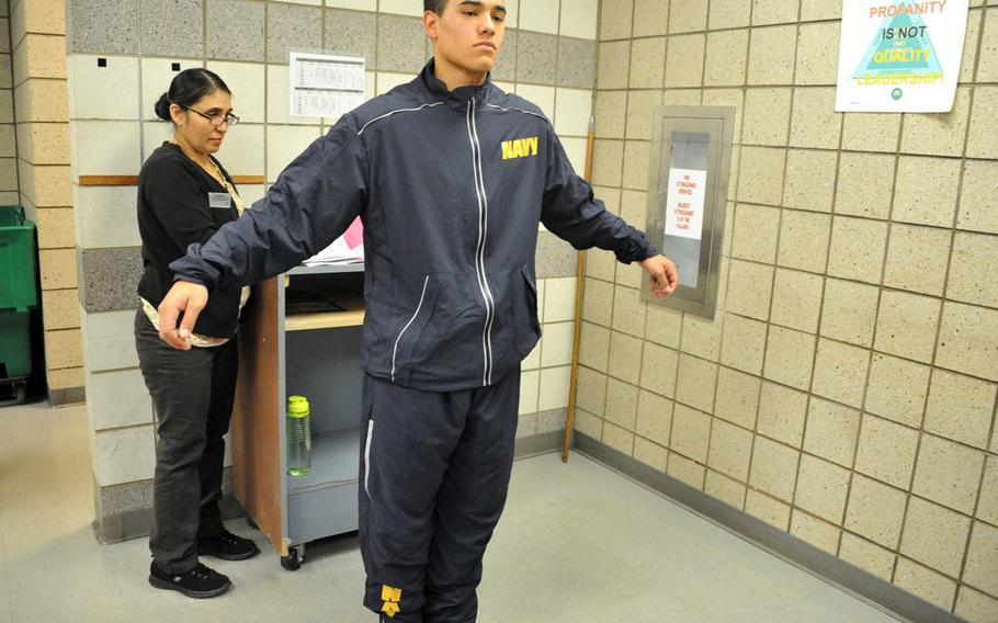 A recruit tries on the Navy's new fitness suit at Recruit Training Command in Great Lakes, Ill., April 24, 2017.