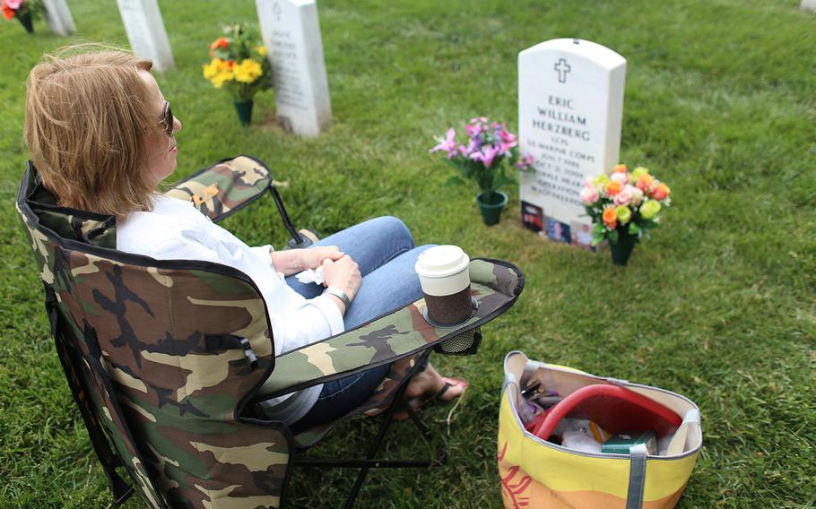 Gold Star Mother Gina Barnhurst visits the grave of her son, Marine Lance Cpl. Eric Herzberg, 20, who was killed in Iraq on Oct. 21, 2006.