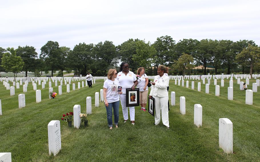The Maryland Chapter of American Gold Star Mothers Inc. restarted informally in 2006 when Gina Barnhurst, left, and Paula Davis, far back left, met at Section 60 at Arlington National Cemetery. Their sons are buried in the same row.