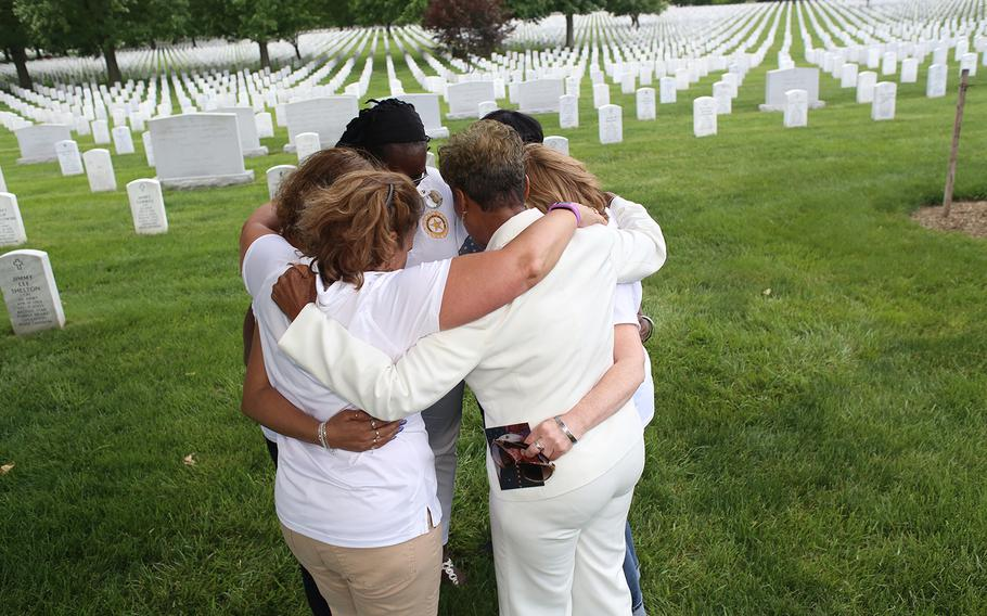 Maryland Gold Star Mothers chapter president Janice Chance, center right, leads the mothers in a prayer after visiting graves at Arlington National Cemetery.