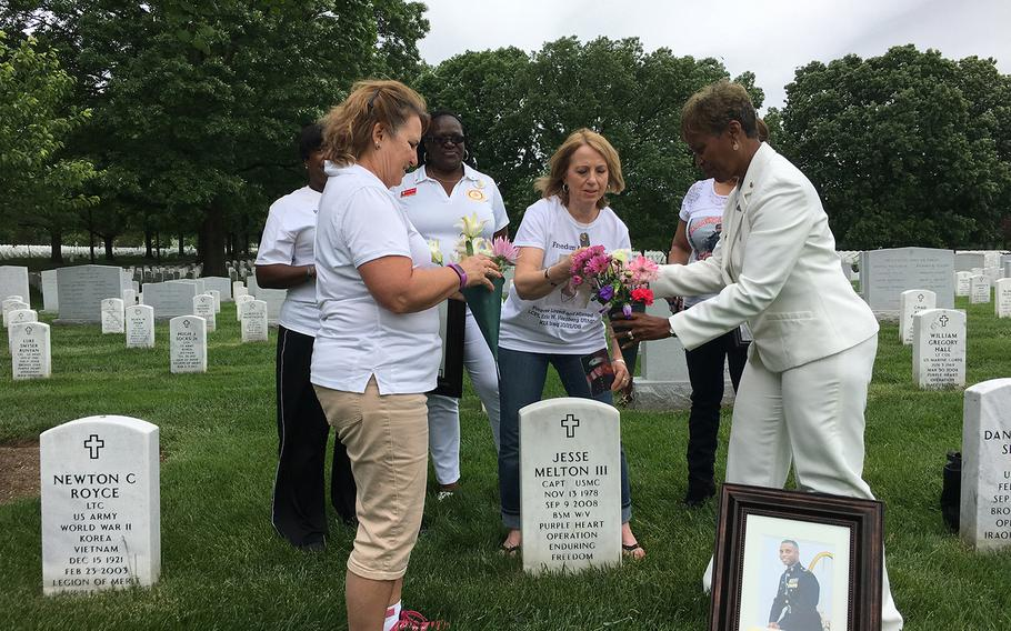 The Gold Star Mothers help Janice Chance, right, lay flowers at the grave of her son, Marine Capt. Jesse Melton III, 29, who was killed in Afghanistan on Sept. 9, 2008.