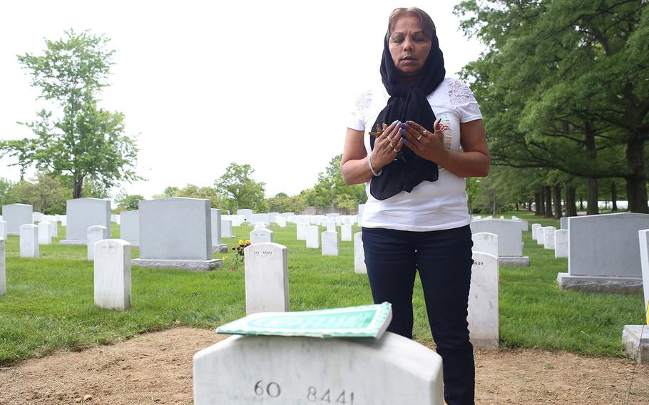 Gold Star Mother Sheba Khan prays at the grave of her son, Marine Cpl. Kareem Rashad Sultan Khan, 20, who was killed in Iraq on Aug. 6, 2007. She said that on the weekends that she cannot make it to Arlington, she ends up feeling like something is missing.
