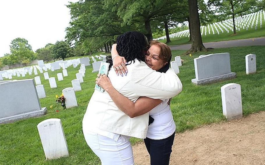 Gold Star Mothers Sheba Khan and Donna Robinson greet each other at Arlington National Cemetery.