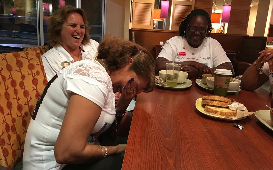 Sheba Khan, left, shares a laugh with the fellow Gold Star Mothers. The women say they understand each other in a way that no one else can.