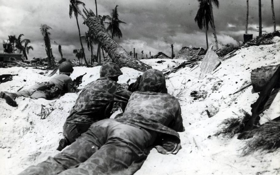 After heavy bombardment, the 2nd Marine Division hit the beaches of Betio Island in the Tarawa Atoll, Nov. 20, 1943. They were met by heavy Japanese resistance, which included thousands of troops in a network of fortified pillbox bunkers and concrete blockhouses.
