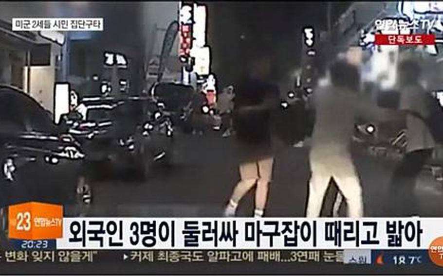 A security camera captures footage of multiple teens assaulting a South Korean man near Sogang University in Seoul on May 23, 2017, according to a Yonhap News TV report on May 28, 2017. The three teens that police arrested are U.S. Forces Korea dependents, military officials said.  SCREENSHOT FROM YONHAP NEWS TV VIA YOUTUBE