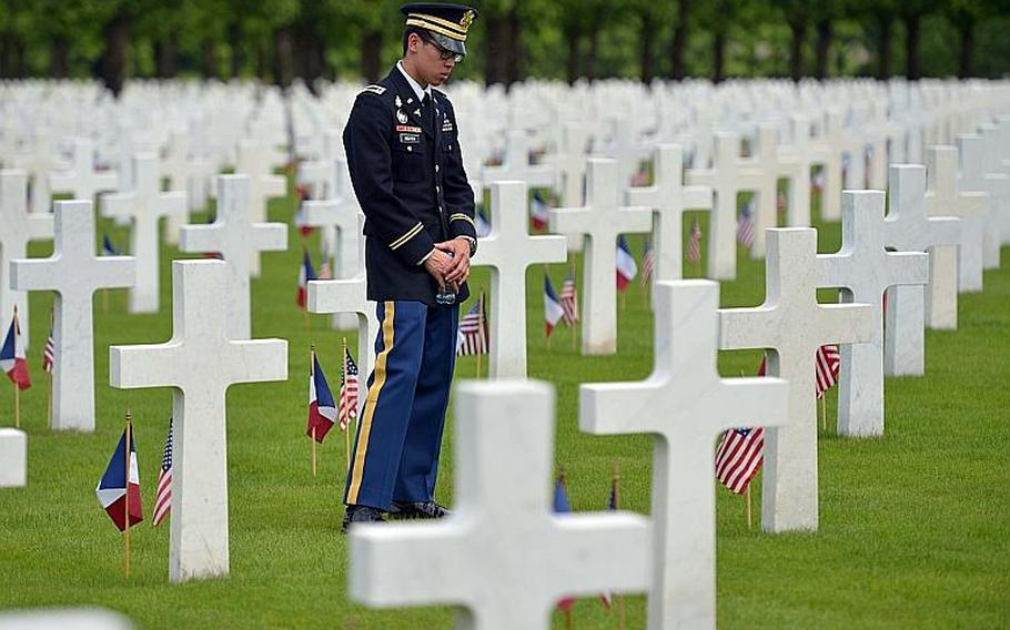 First Lt. Huy Nguyen of the 421st Medical Battalion out of Baumholder, Germany, reads the names on some of the graves following the Memorial Day ceremony at Meuse-Argonne American Cemetery in Romagne-sous-Montfaucon, France, Sunday, May 28, 2017.  With 14,246 American World War I dead buried here, it is the largest American cemetery in Europe.
