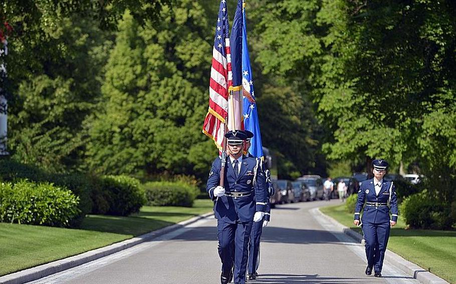 The U.S. Air Force honor guard from Ramstein Air Base marches in the colors at the beginning of the Memorial Day ceremony at Meuse-Argonne American Cemetery in Romagne-sous-Montfaucon, France, Sunday May 28, 2017.