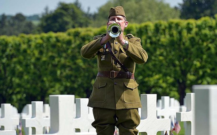 Dressed in a World War I-era uniform, Pascal Bouilleaux plays ''Taps'' at the end of the Memorial Day ceremony at Meuse-Argonne American Cemetery in Romagne-sous-Montfaucon, France, Sunday May 28, 2017.