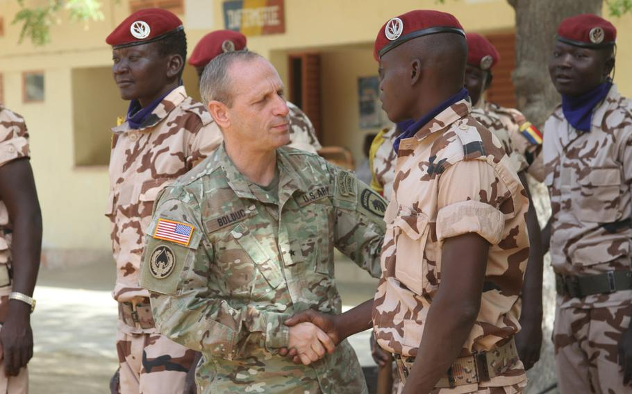 Brig. Gen. Donald Bolduc, commander, Special Operations Command Africa, greets Chadian personnel participating in the Flintlock 2017 closing ceremony on March 16, 2017, in N'Djamena, Chad. Bolduc said in an article published in the online Small Wars Journal that the lack of a U.S. government strategy hinders operations against extremists in Africa.