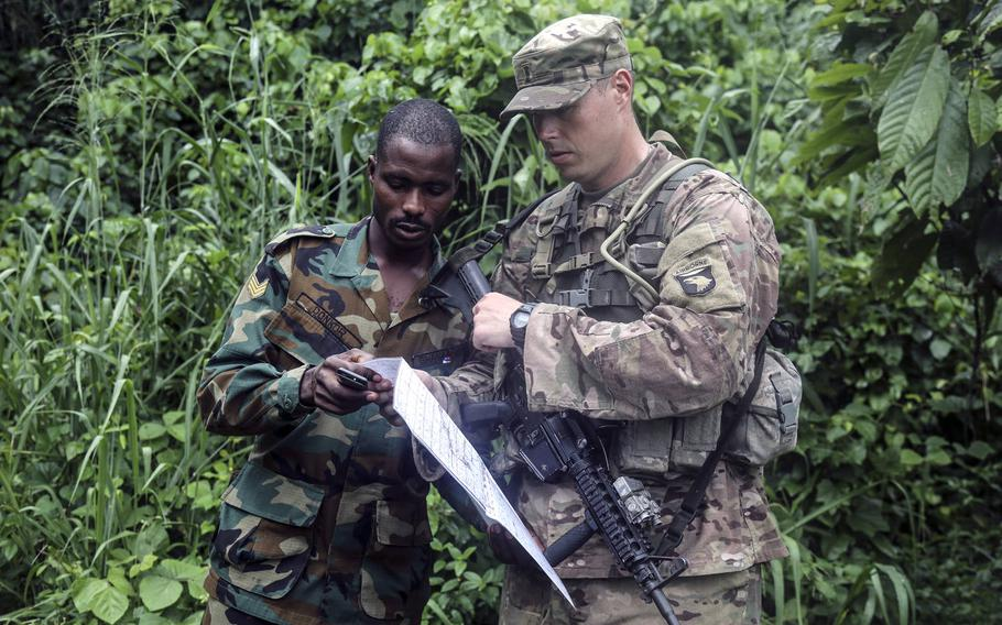 Ghana Armed Forces Sgt. Kofi Francis Donkor reviews his position on a map with U.S. Army 2nd Lt. Hugh Smith during United Accord 2017 at the Jungle Warfare School on Achiase military base, Akim Oda, Ghana, May 26, 2017.
