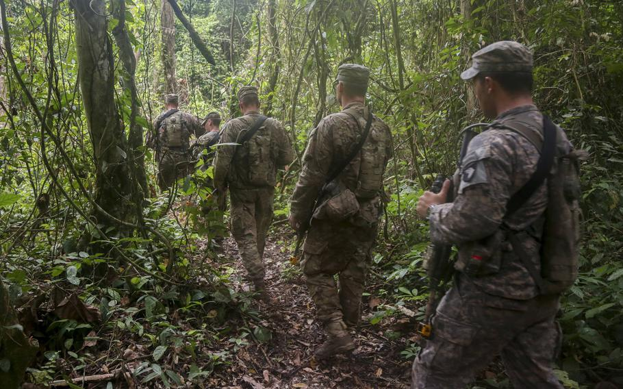 U.S. soldiers assigned to the 1st Battalion, 506th Infantry Regiment, 1st Brigade Combat Team, 101st Airborne Division, maneuver through the jungle during United Accord 2017 at the Jungle Warfare School on Achiase military base, Akim Oda, Ghana, May 26, 2017.