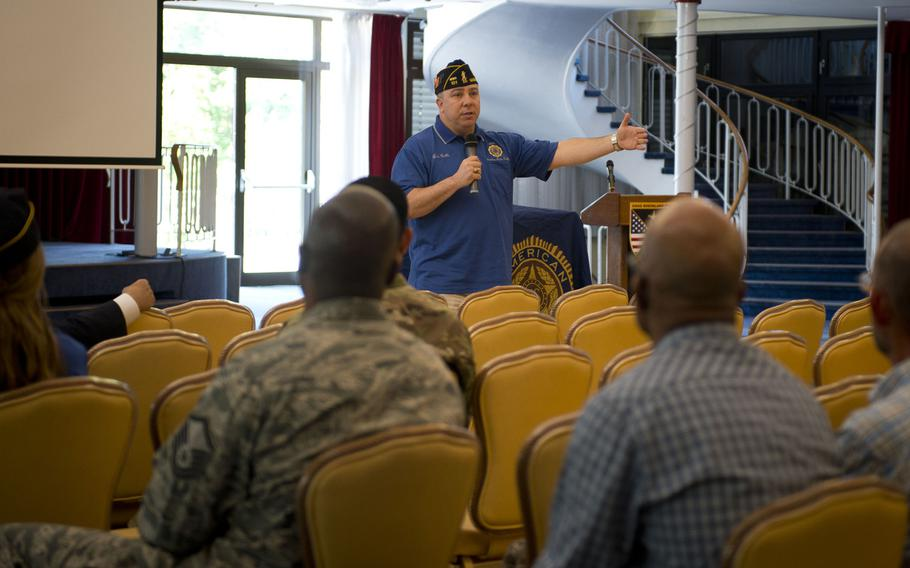 Lou Celli, American Legion National Veterans Affairs and Rehabilitation Division Director, speaks to audience members during a town hall meeting in Kaiserslautern, Germany, on Wednesday, May 31, 2017.