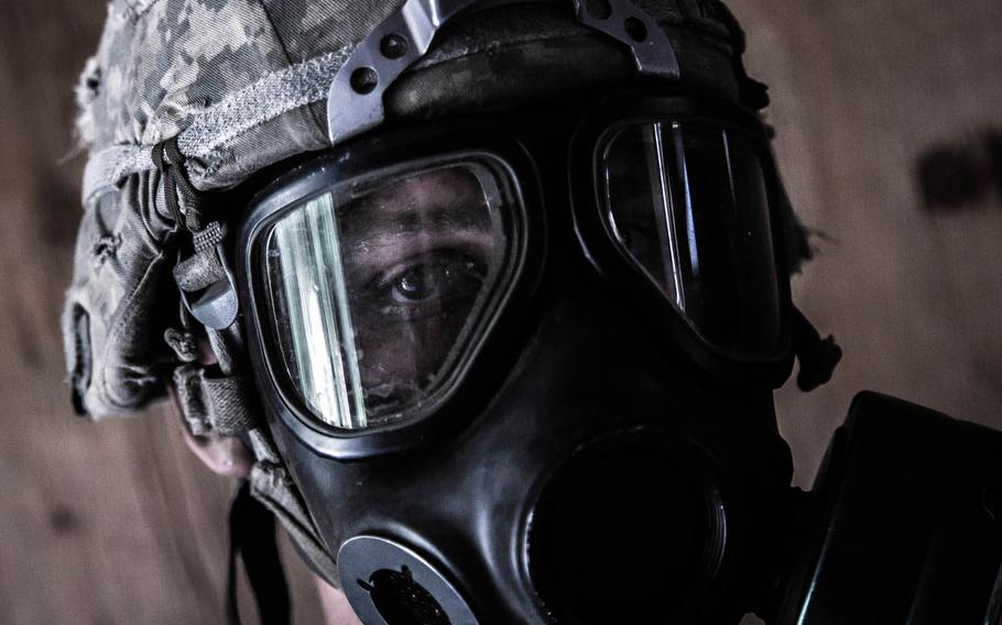 A soldier from 1st Battalion, 5th Infantry Regiment, 1st Stryker Brigade Combat Team, 25th Infantry Division out of Fort Wainwright, Alaska, wears chemical-resistant gear while training at Rodriguez Live Fire Range, South Korea, Sunday, June, 4, 2017.