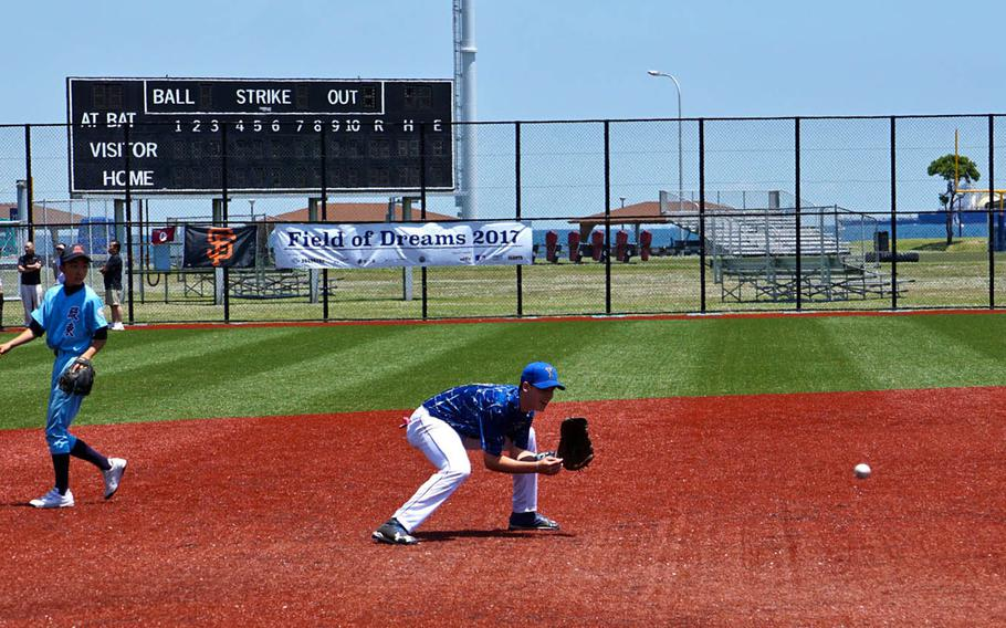A player from Yokota High School goes after a ground ball during the Field of Dreams baseball clinic at Yokosuka Naval Base, Japan, Sunday, June 4, 2017.