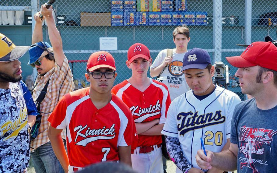 Players listen to a pep talk during the Field of Dreams baseball clinic at Yokosuka Naval Base, Japan, Sunday, June 4, 2017.