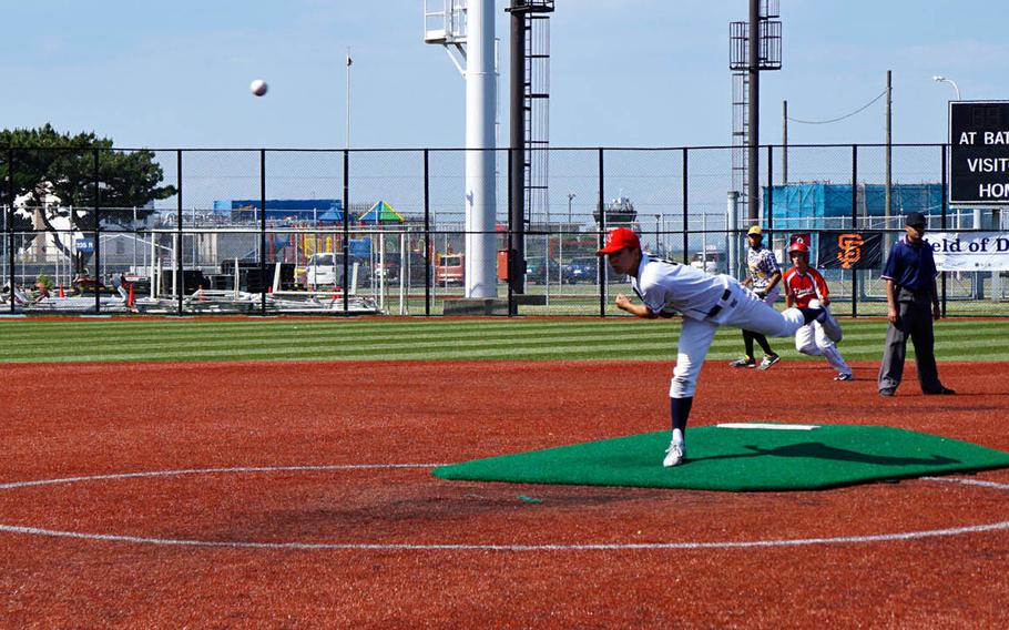 A player from St. Mary's International School in Tokyo pitches during the Field of Dreams baseball clinic at Yokosuka Naval Base, Japan, Sunday, June 4, 2017.