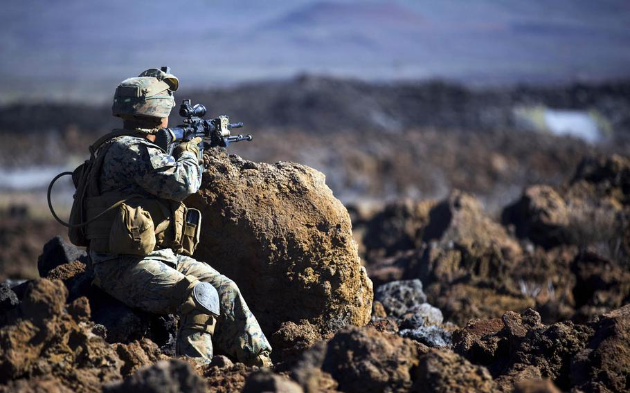 A Marine with Alpha Company, 1st Battalion 3rd Marine Regiment scans the horizon of Pohakuloa Training Area, Hawaii, during the Lava Viper exercise, an annual combined arms training drill that includes artillery and air support, Nov. 2, 2016.