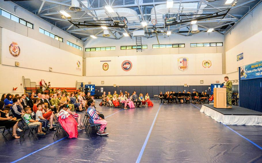Rear Adm. Brad Cooper, Navy Region Korea commander, speaks during the closing ceremony for C.T. Joy Elementary/Middle School at Chinhae Naval Base, South Korea, June 2, 2017.