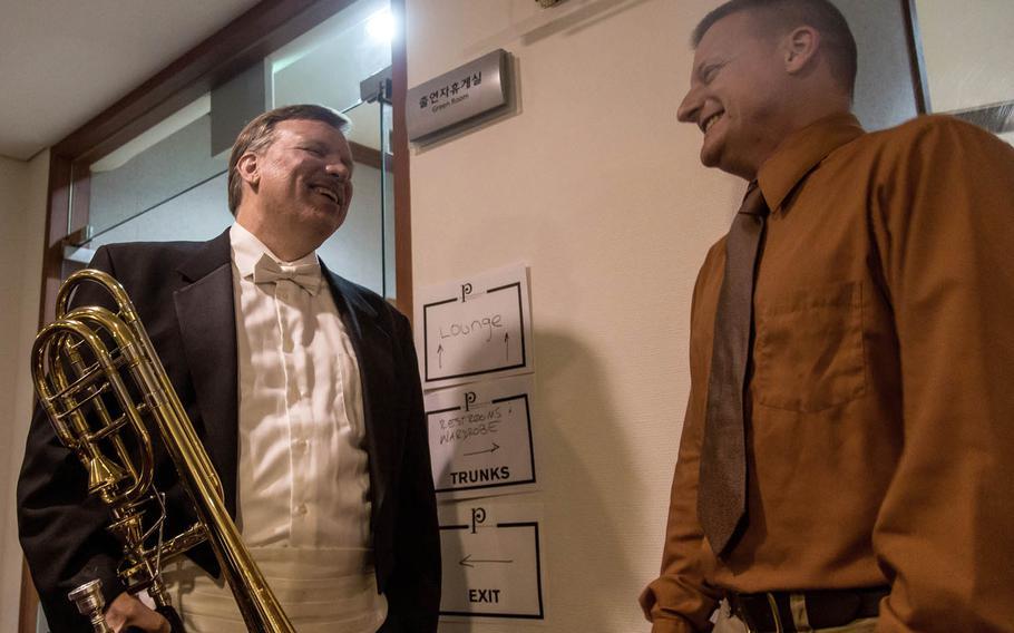 Blair Bollinger, left, a trombonist for the Philadelphia Orchestra, greets Staff Sgt. James Beeson, a trombonist for the 8th Army Band, backstage at the Seoul Arts Center's Music Hall, Thursday, June 8, 2017.