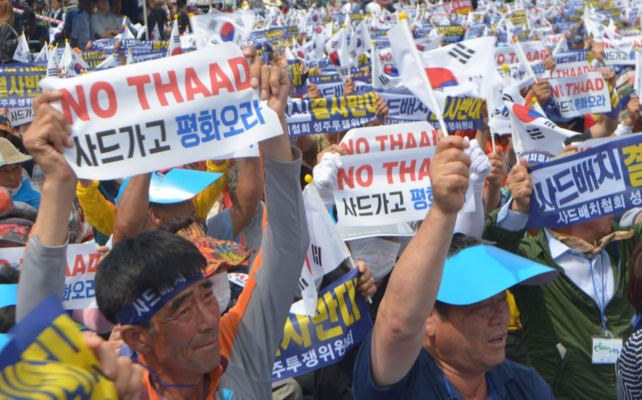 """About 2,000 people rallied outside the main train station in Seoul, South Korea, July 21, 2016. Wearing yellow capes and waving banners that said """"No THAAD,"""" they called on the government to reverse its decision to deploy the Terminal High Altitude Area Defense system in Seongju."""