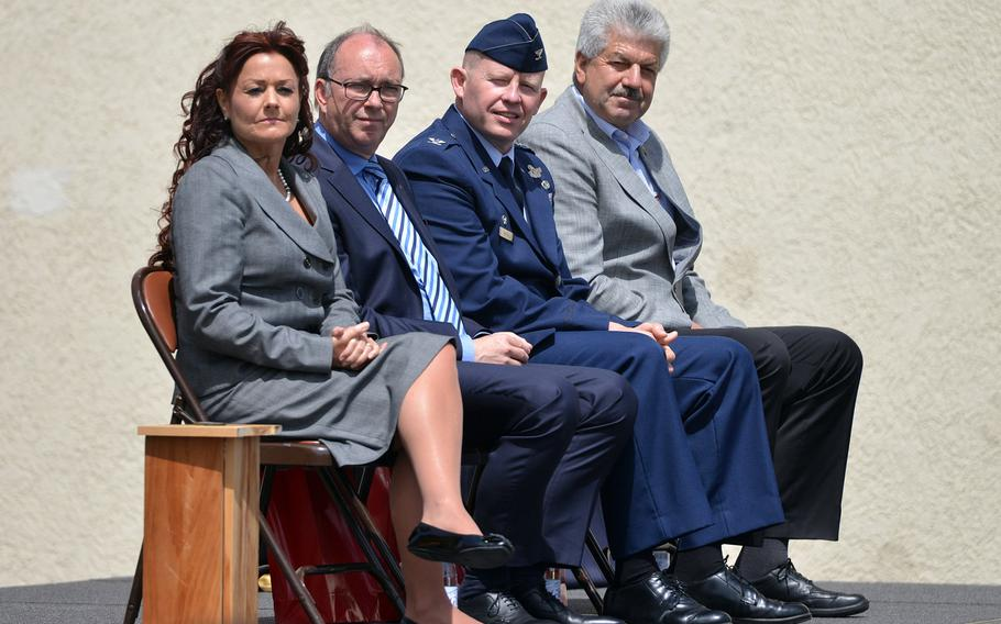 The speakers at the Bitburg High School closing ceremony listen to the school band play ''Pictures at an Exhibition,'' Thursday, June 8, 2017. From left are school principal Jennifer Remoy, Michael Ringelstein, the deputy mayor of Bitburg, Col. Joseph McFall, 52nd Fighter Wing commander, and Spangdahlem Mayor Klaus Rodens.