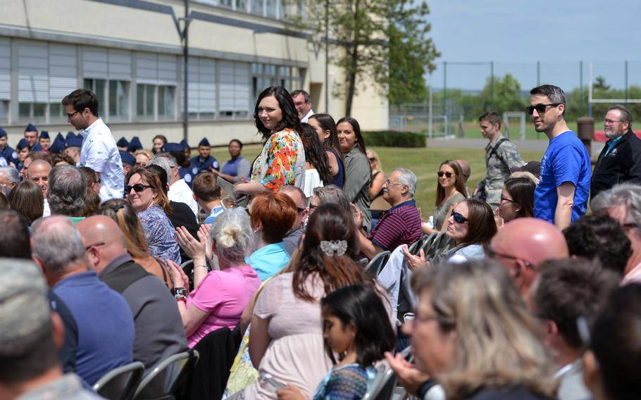Returning Bitburg High School alumni stand while being recognized at the school's closing ceremony in Bitburg, Germany, Thursday, June 8, 2017.
