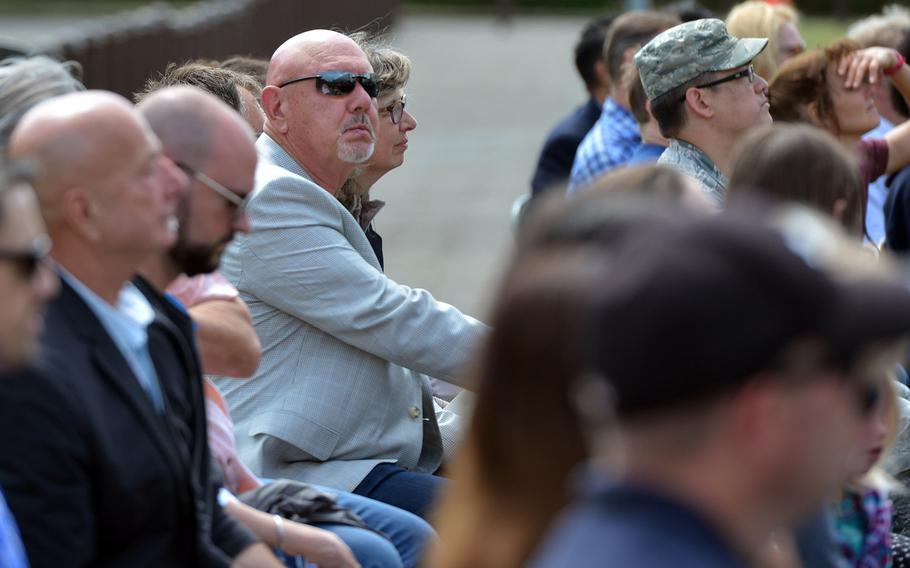Bitburg High School alumnus Robert Frost, center with sunglasses, listens to speeches at the school's closing ceremony, Thursday, June 8, 2017. Frost attended Bitburg High from 1961 to '63. He was visiting German friends in Bitburg who surprised him by taking him to the ceremony.