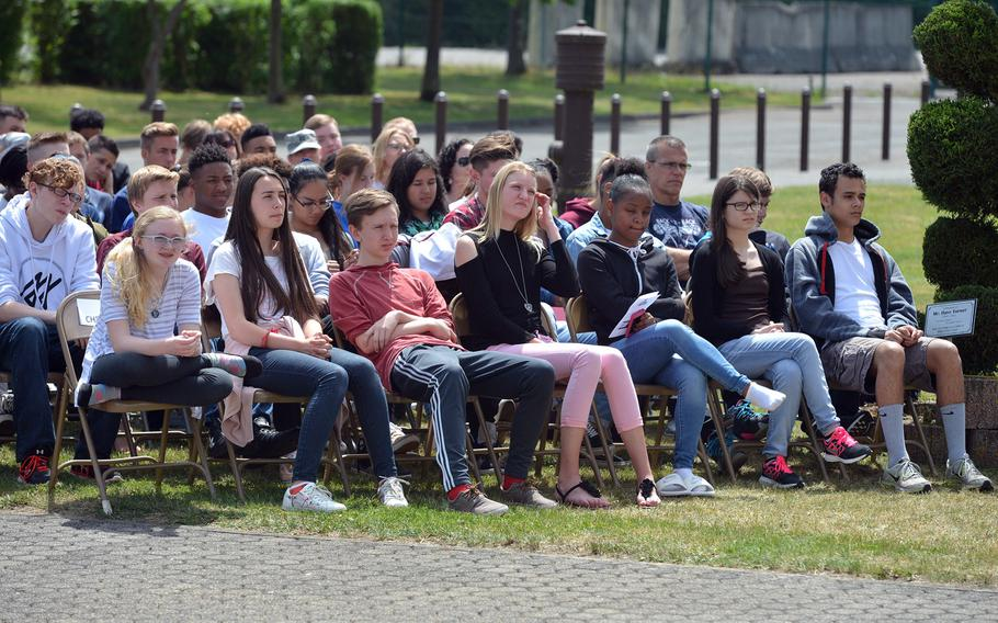 Bitburg High School students listen to speeches during their school's closing ceremony Thursday, June 8, 2017. The school is closing after 60 years. The students will go to the newly established Spangdahlem High School next school year.