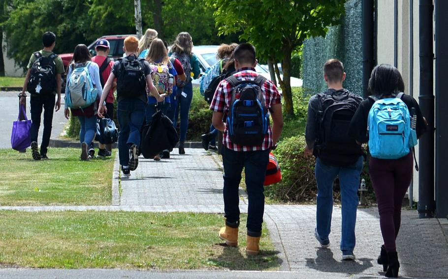 Bitburg High School students walk away from the school at the end of the day that saw a closing ceremony for the school, which is shutting its doors after 60 years of service, on Thursday, June 8, 2017.
